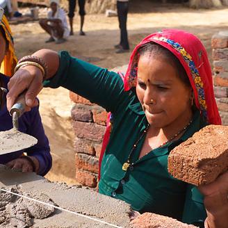 Women building a wall