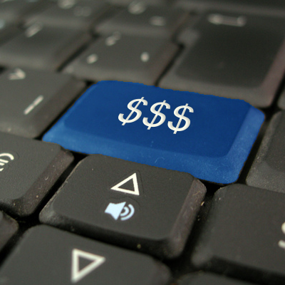 Keyboard with a special blue key with 3 dollar signs on it
