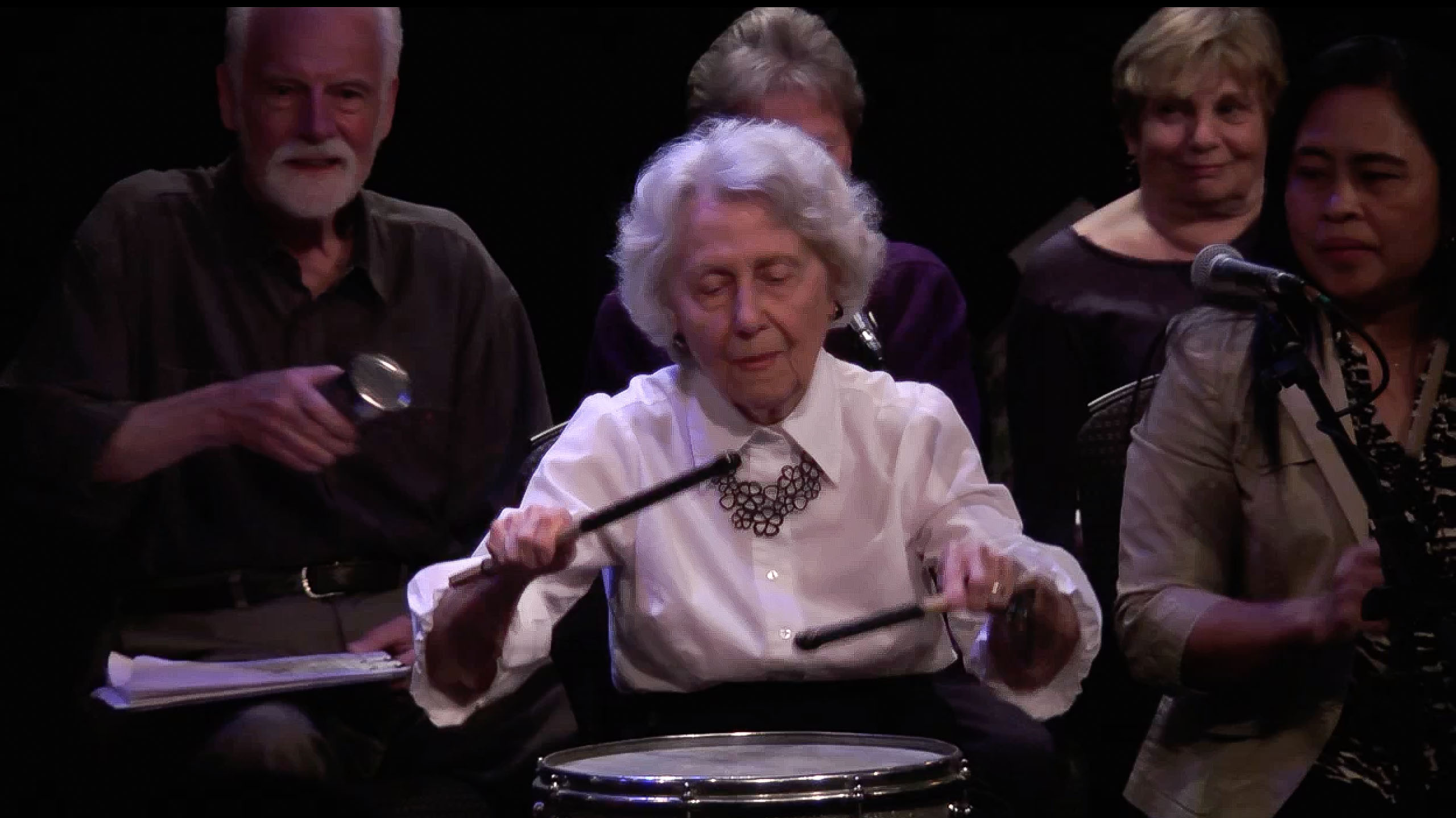 An elder plays percussions