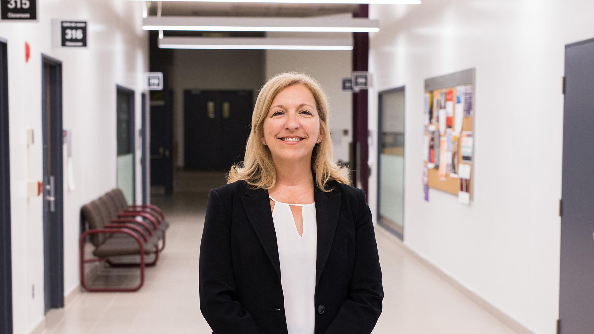 Michelle Giroux in a hallway