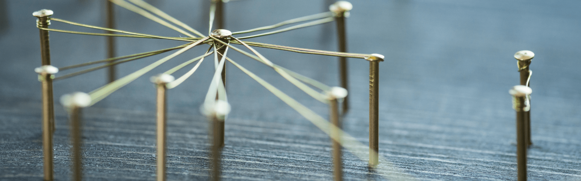 image of pins connected by a wire