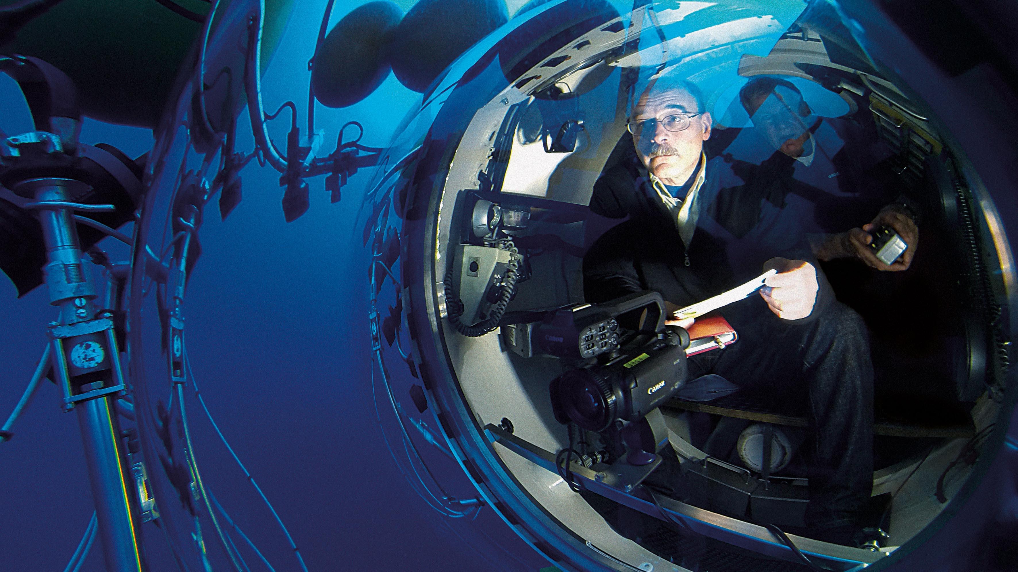 A man sitting in a submarine