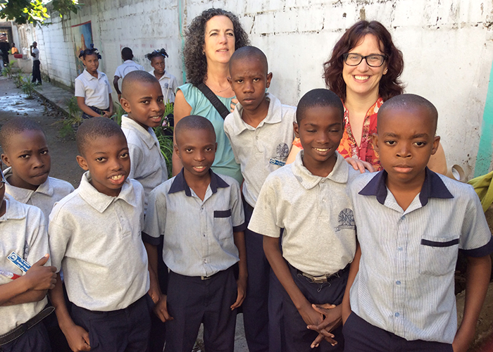 Beverly Baker surrounded by young Haitian students